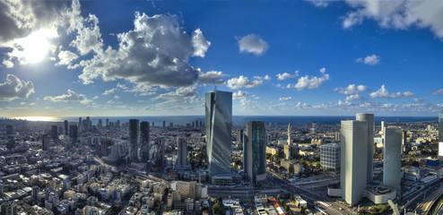 Aerial view of tel aviv skyline with urban skyscrapers, blue cloudy sky and the mediterranean sea, Israel