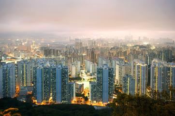 Illuminated city at dusk, Hong Kong, China