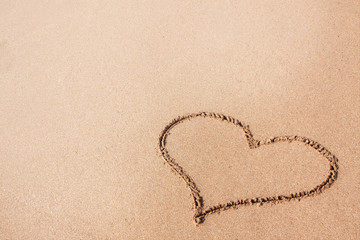 Drawing of a Heart on a Yellow Sand Beach.