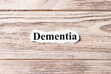 Dementia of the word on paper. concept. Words of Dementia on a wooden background