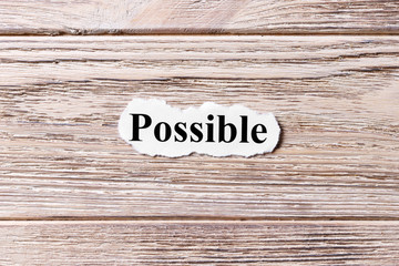 possible of the word on paper. concept. Words of possible on a wooden background