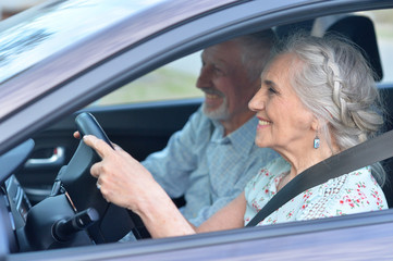 senior couple driving car