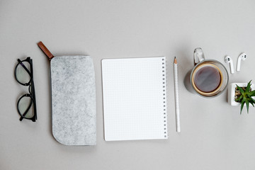 Top view of stationery and telephone, coffee  on grey desktop background. Business concept