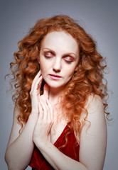 portrait of  beautiful lady with long curly red hair
