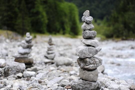 Stone cairns near the river at Hinterriss Eng, Karwendel mountains, Tyrolese limestone alps, Tirol, Austria