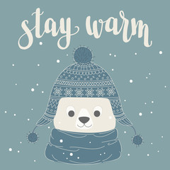 Polar bear in a warm hat and scarf