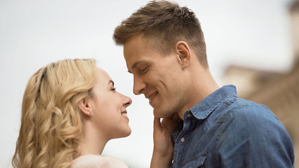 Couple in love looking at each other, romantic date, tender feelings, close-up
