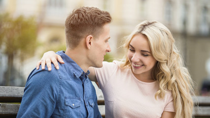 Tender student couple hugging with smiles on faces, first love story, happiness
