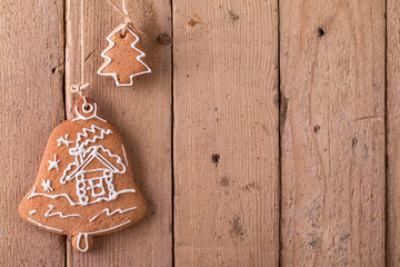 Christmas gingerbread hanging over wooden background