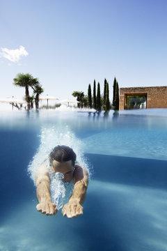 Man diving in pool, Saint Saturnin les Apt, Provence, France