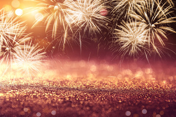 Fototapete - Gold and Red Fireworks and bokeh in New Year eve background holiday.