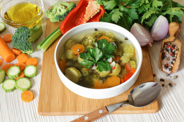 Light vegetable soup and ingredients.