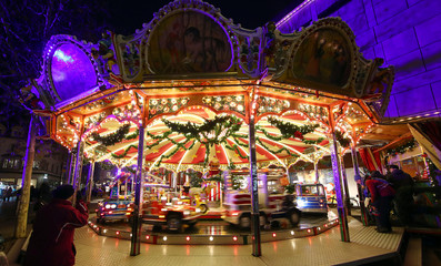A children's merry-go-round at the Christmas market in Regensburg