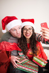 Happy Christmas Couple taking a selfie on phone