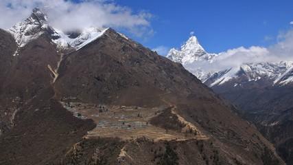 Sherpa village Phortse and snow covered mount Ama Dablam. Spring scene in the Sagarmatha National Park, Nepal.
