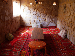The arab living tee room with sofas and pillows for the meetings, guests, tee discussions, tee time wit decorated ceiling /  the typical furniture in North Africa, Morocco, Fes, Marakkesh, Casablanca