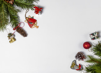 Christmas composition. Christmas sock, fir branches, gift, toy and pine cones on a white background. Flat, top view