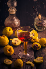 Tincture cup fruit quince wooden table