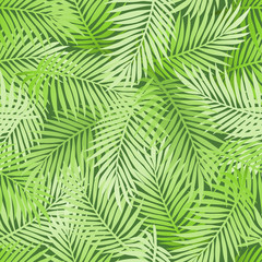 Exotic tropical light green banana palm leaves on dark green background. Seamless natural floral pattern