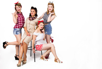 Four young cool pin-up women on white background