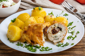 Chicken breast stuffed with cheese and dried tomatoes.