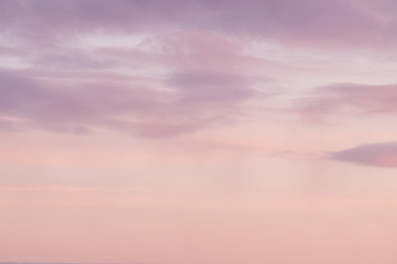 Background from the clouds at sunset or dawn with space for text
