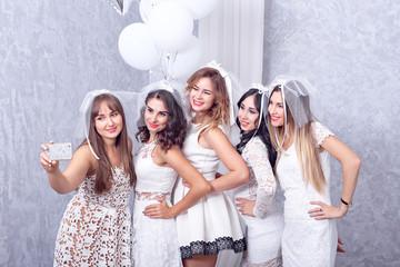 Group of five happy elegant female friends