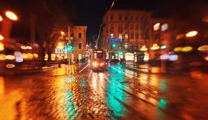 city night street paving stone bench