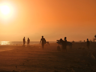 Golden hour on the California beach, surfers, photographers, people