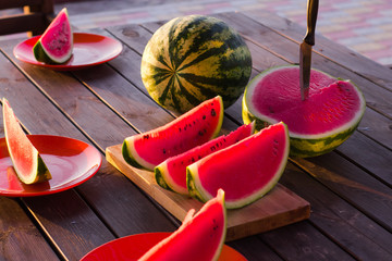 Fresh watermelon slices on wooden table, summer time colorful background