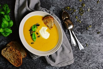 Delicious Pumpkin Soup on the dark background
