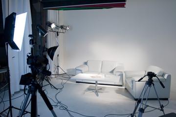 Empty white photo studio white lightting and tripods