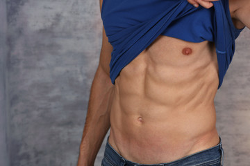 Sport man showing abdominal muscles and obliques. Six pack workout results