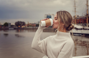 Young woman enjoying her coffee outdoors