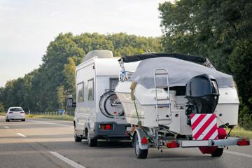 Caravan with trailer for motor boats road in Switzerland