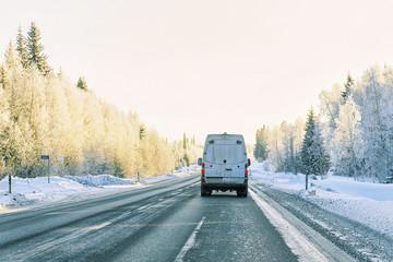 Minivan on road in winter Rovaniemi