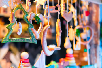 Stand with wooden toys and Christmas tree decorations Riga