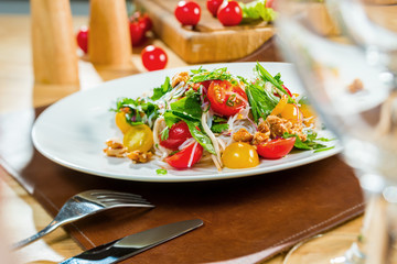 salad with fresh vegetables and cherry tomatoes with Asian noodles