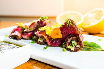 marinated and fried pieces of veal in rolls, tataki rolls, selective focusing,