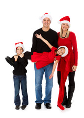 Christmas: Holiday Family Holds Up Little Girl