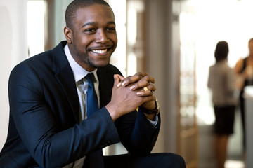 Elegant african american new hire business man in office environment with charming excited smile