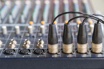 The XLR connectors on the audio mixers.