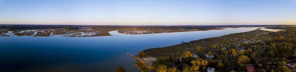 Aerial panorama of coastal community at sunset