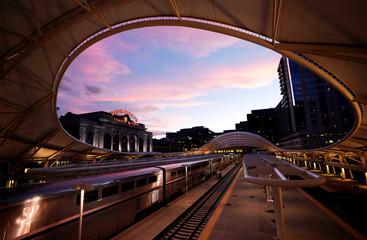 A train arrives at Denver's Union Station at sunset in downtown Denver