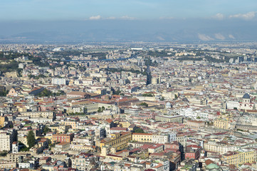 Scenic landscape view across the historic city centre of Naples, Italy to Mount Vesuvius on the horizon
