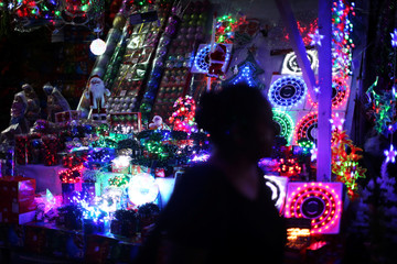 A woman walks by at the Christmas market at the Simon Bolivar park in San Salvador