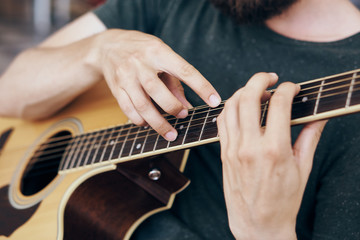 Man holds a guitar, music, musical instrument, strings, hands, musician