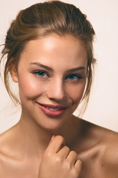 a girl smiling with nude make up