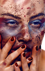 Close up of a girl face covered with colors