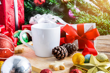A cup of tea or coffee with Festive Decoration, Christmas and New Year on wooden table